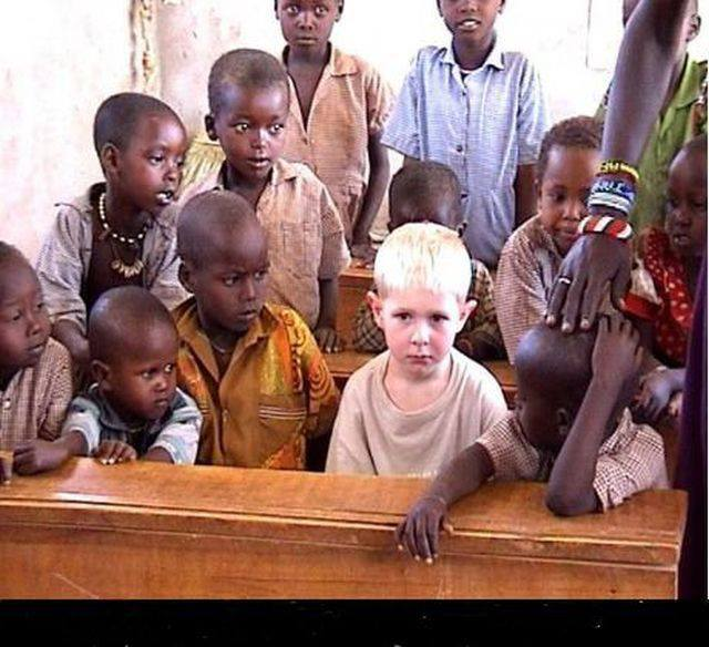 little-black-boys-crowd-around-little-blond-nordic-boy1.jpg